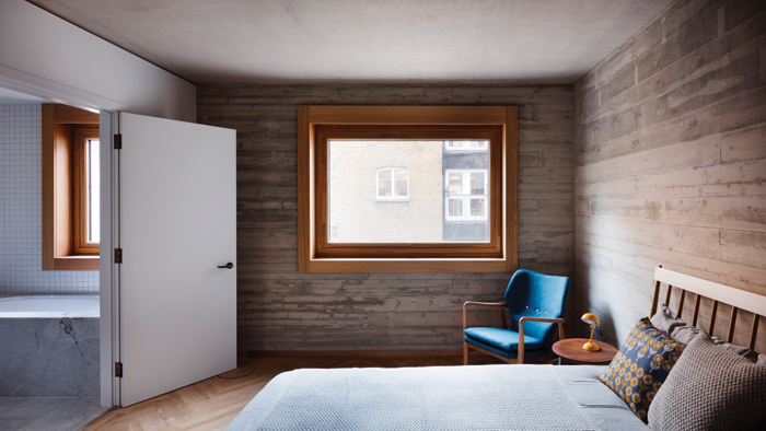 Large windows with thick timber frames bring an abundance of light into the apartments. Image Credit: Rory Gardiner