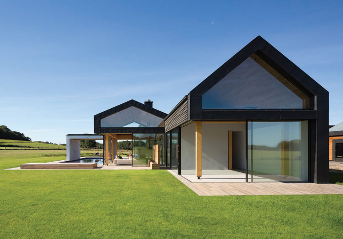Large panels of glazing slide from the corners to merge the boundary between inside and out