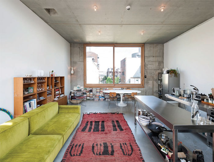 The fourth floor living room-kitchen commands a view into the heart of the power station