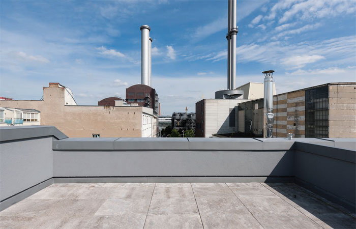 The metallic flues of the power station are echoed in the vGGG's stainless steel chimney beside the roof terrace