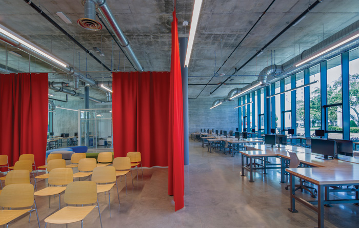 Inside, the studio is stripped back and open plan, with mobile offices and felt curtains enabling flexible spaces. Image Credit:  Miami in Focus
