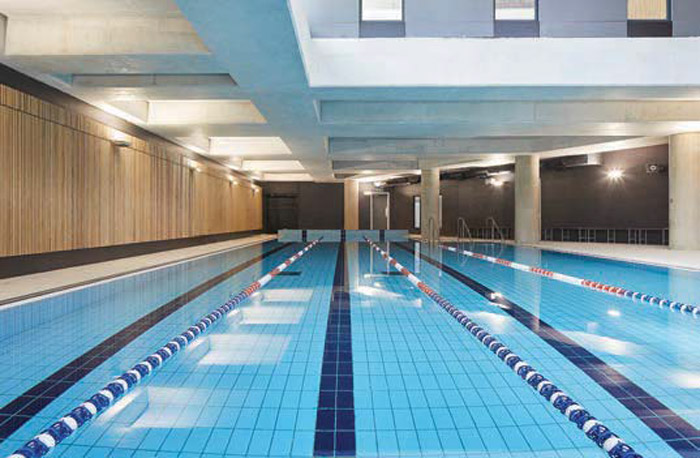 The basement pool in the site's sharp eastern end required the floors above to be suspended. Image Credit: Hufton+Crow