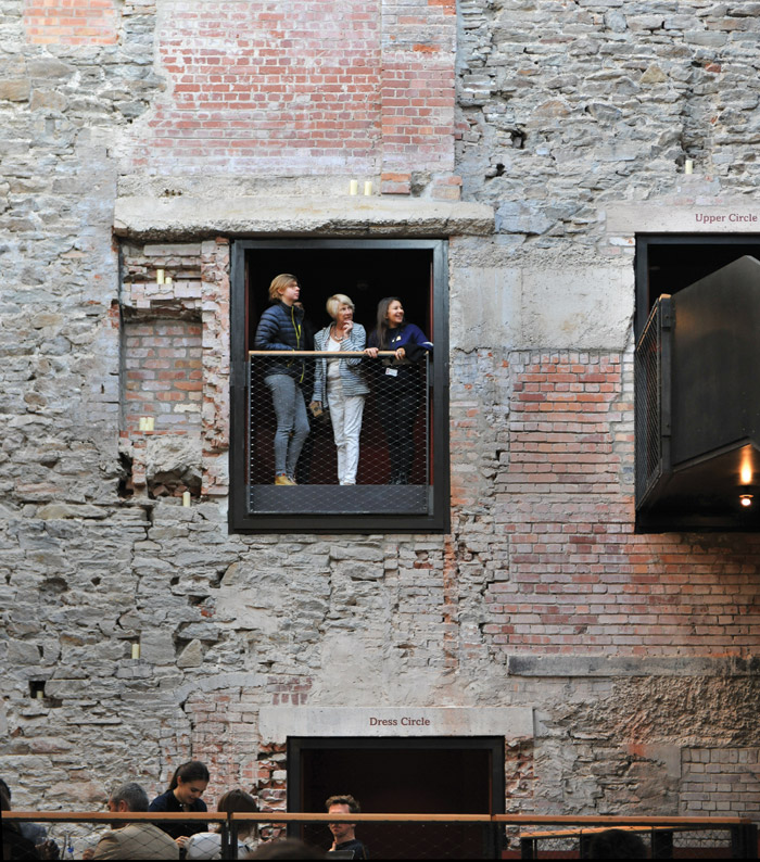 The 1766 theatre wall exposes layers of history, including red brick patches from the 1880s. Image Credit: Philip Vile