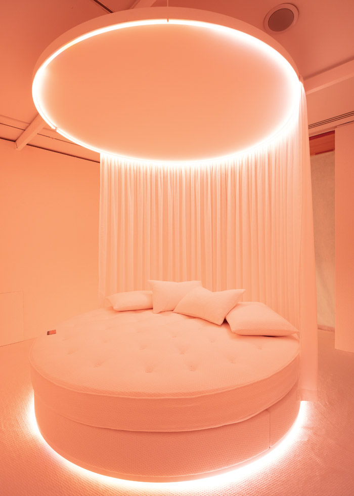 For her installation, Schmid created a circular bed with sound and light guiding visitors through their circadian cycle. Image Credit: Francisco Ibáñez Hantke