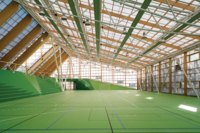 The Crystal (2006), a sports hall and culture centre in Copenhagen's Amager suburb, fuses structural glulam and steel with a facade of polycarbonate. Image Credit: Torben Eskerod
