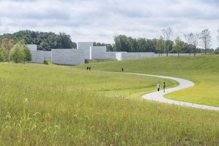 The approach to the museum via a pedestrian walkway is carefully choreographed to connect the visitor to their senses. Image Credit: Iwan Baan, Courtesy Of Thomas Phifer and Partners