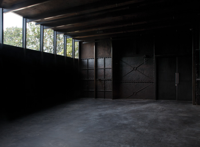 The cast-iron Daskalopoulos Tank Gallery, previously used to store the water for the baths. Image Credit: Assemble