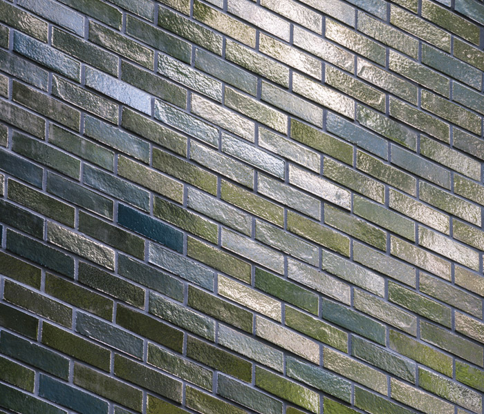 A central panel of glazed bricks on the facade complements and reflects the leafy character of the street. Image Credit: Gareth Gardner