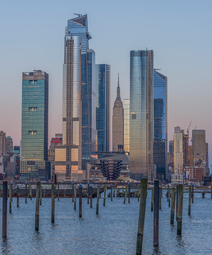 The view of Hudson Yards as seen from New Jersey, across the Hudson River, with the Empire State Building framed above Vessel. Credit: Wade Zimmerman