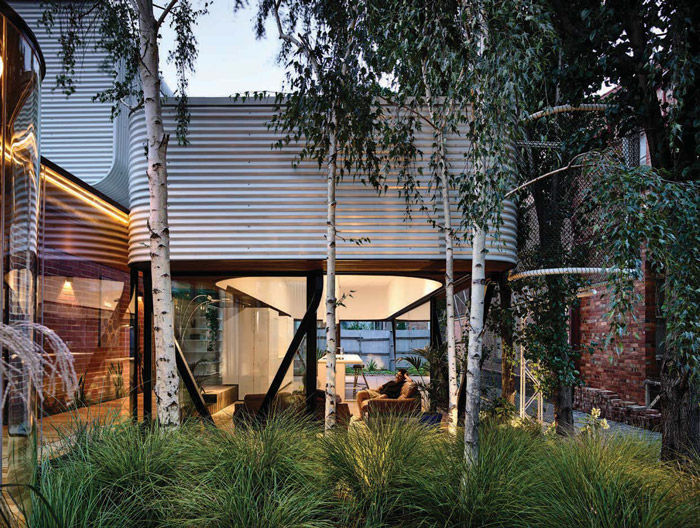 The hub of the family home opens effortlessly on to the garden. Image Credit: Derek Swalwell