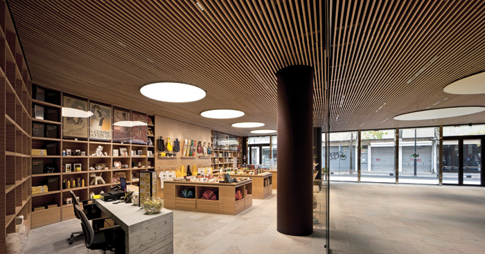 The palette of materials offers haptic delight, including the thin, wood strips made from European beech which line the ceiling
