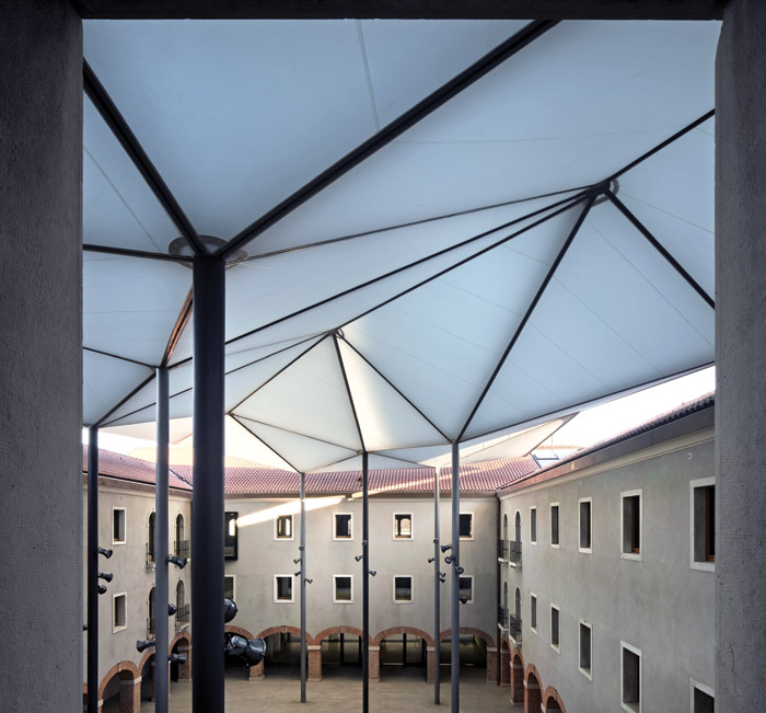 Sauerbruch Hutton has created a geometrical ETFE parasol to shelter the former convent's central courtyard