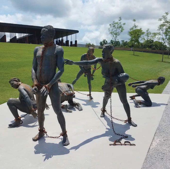 The first thing visitors see on entering the memorial is a sculpture by Ghanaian artist Kwame Akoto-Bamfo, depicting a group of slaves struggling in chains Image Credit: Adina Solomon