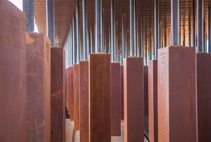 Eight hundred 1.8m-long rectangular corten steel monuments hang from the roof of the memorial square, one for every American county where a lynching took place. Each one bears the victims' names. Image Credit: Equal Justice Initiative