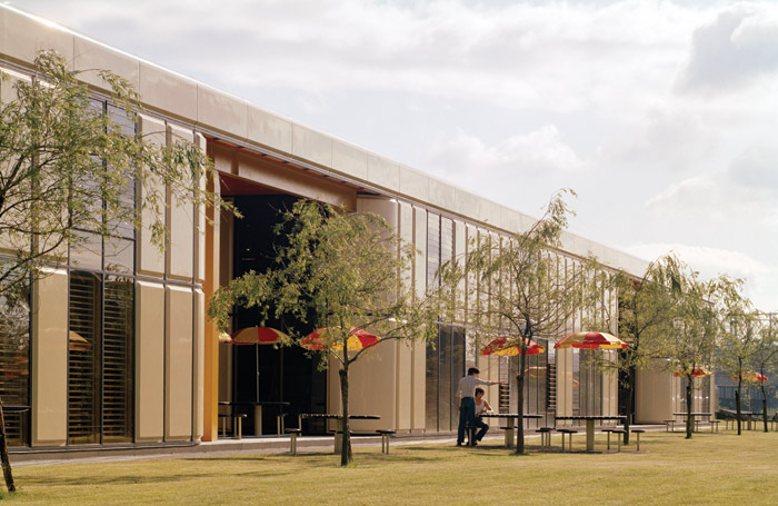 The highly adaptable Herman Miller Factory near Bath and with Nicholas Grimshaw outside the building. Image Credit: Grimshaw