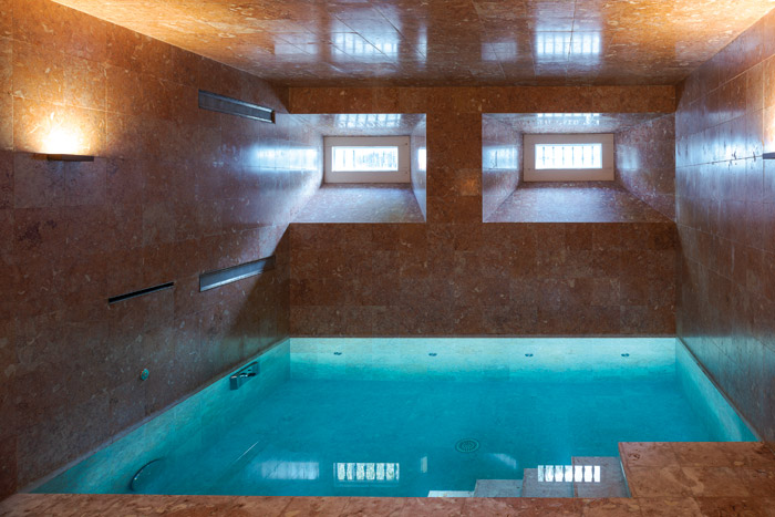 Although below street level, the swimming pool receives natural light. Image Credit: DMF