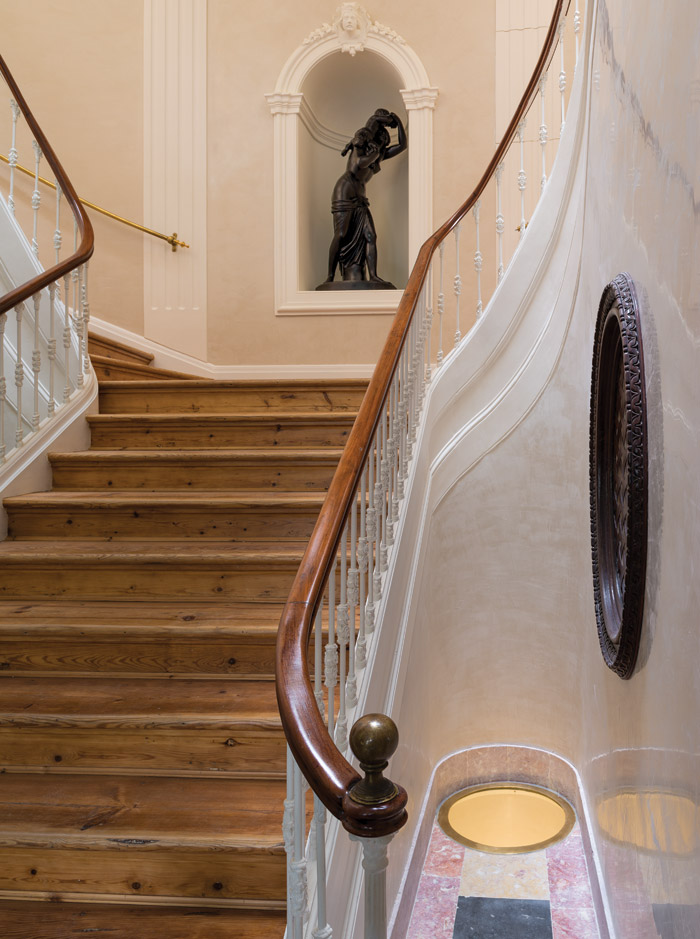 The central staircase is adorned with neoclassical romantic muses, this one in an alcove. Image Credit: DMF