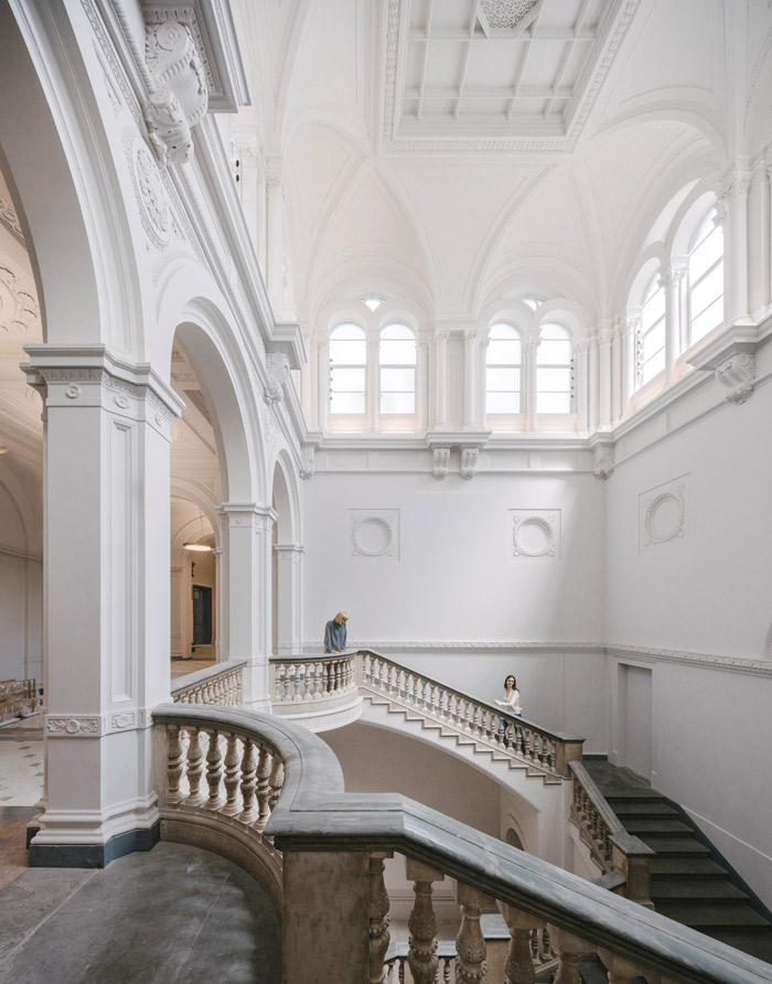 The Wohl entrance hall has been stripped back, painted an architectural pale grey, and original flooring revealed, which may not sound like much but it clarifies and unites the experience. Image Credit: Simon Menges