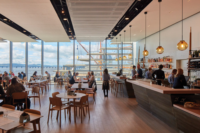 The first-floor restaurant — Tatha Bar and Kitchen, designed by Lumsden Design — boasts superb river views via floor-to-ceiling windows