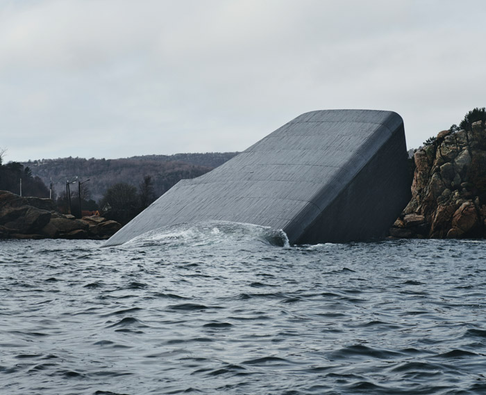 Despite the concrete almost blending in with the rocky shore, on first glance the project looks as if a building has fallen into the sea. Credit: Ivar Kvaal