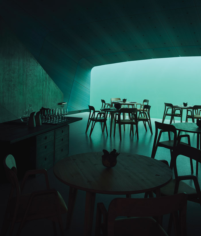 Once down on the restaurant level, everything is bathed in a cool turquoise light (in daytime, at least). Credit: Ivar Kvaal