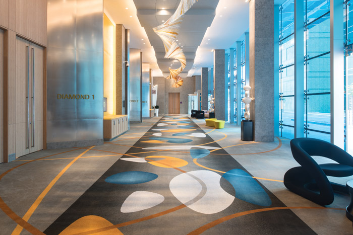 Wilson Associations asked Ulster Carpets to create bespoke Op Art carpets for the Sofitel Dubai Downtown Flooring: Ulster Carpets. Image Credit: Momentary Awe Photography