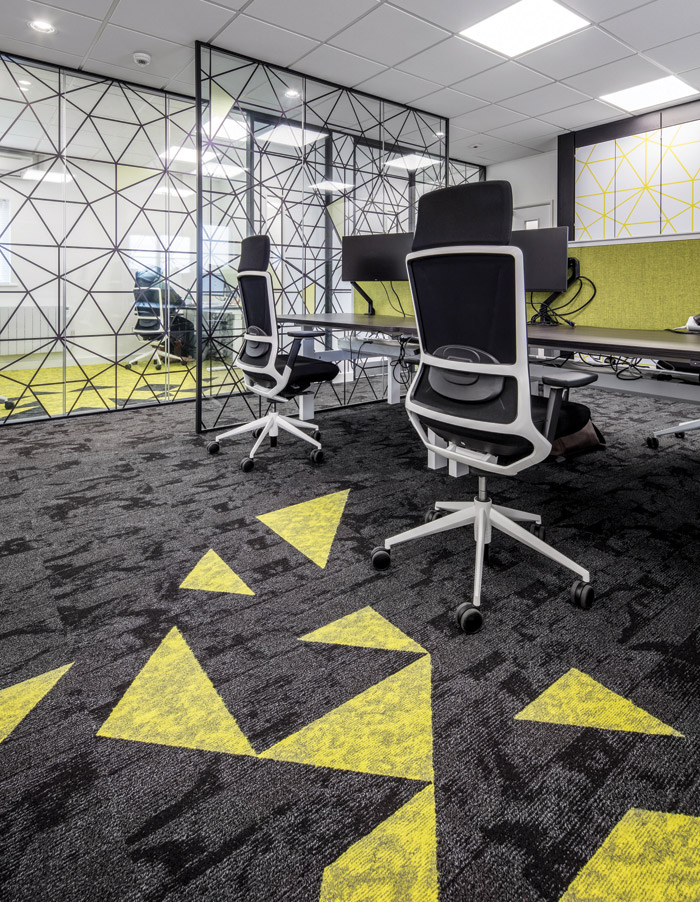 Officescape interior design company refurbished its own Cambridge office using bright yellow geometric accents for vibrancy Flooring: Modulyss Txture