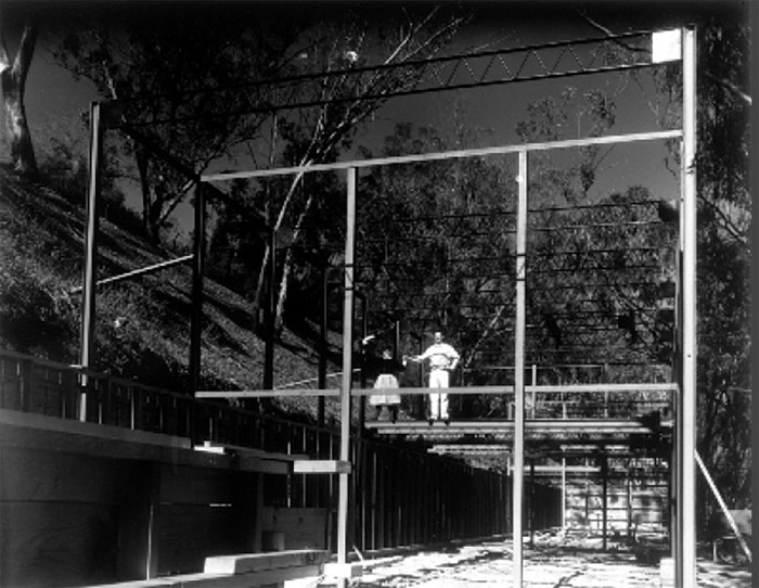 Ray and Charles Eames pose on the construction site of the house in 1949. Image credit: © Eames Office LLC (www.eamesoffice.com). All rights reserved.
