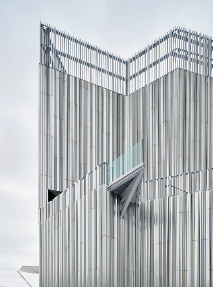 With its irregular, sharp-angled outline and aluminium facade, the building can at times appear cold and bleak. Image credit: Scott Mcdonald / Gray City Studios.