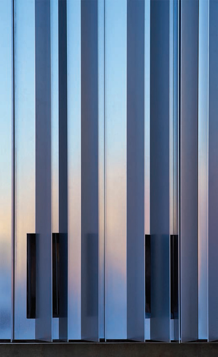 It's when the weather shifts and the sunlight interacts with the angled aluminium fins that the building comes 'alive', shimmering in the urban landscape. Image credit: Scott Mcdonald / Gray City Studios