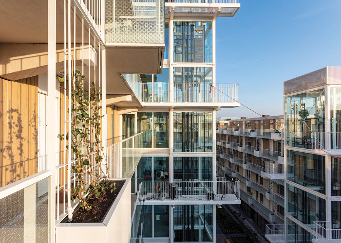 Massing and layout ensure daylight and sunshine reach into the large central courtyard space and surrounding balconies. Image credit: Marc Goodwin