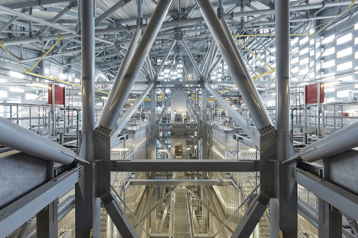 The machinery inside the power plant is arranged to enable the sloping roof of the building