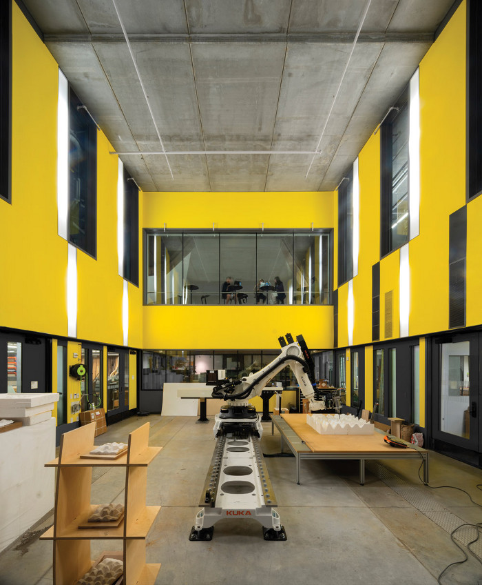 The double-height, subterranean Fabrication Lab. Image credit: Nic Lehoux.