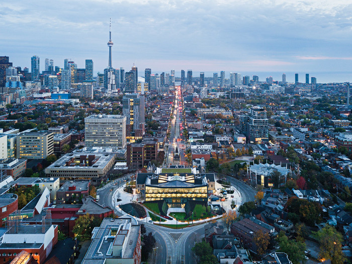 The Daniels Building occupies a circle in the middle of Spadina Avenue in central Toronto. Image Credit: Michael Muraz