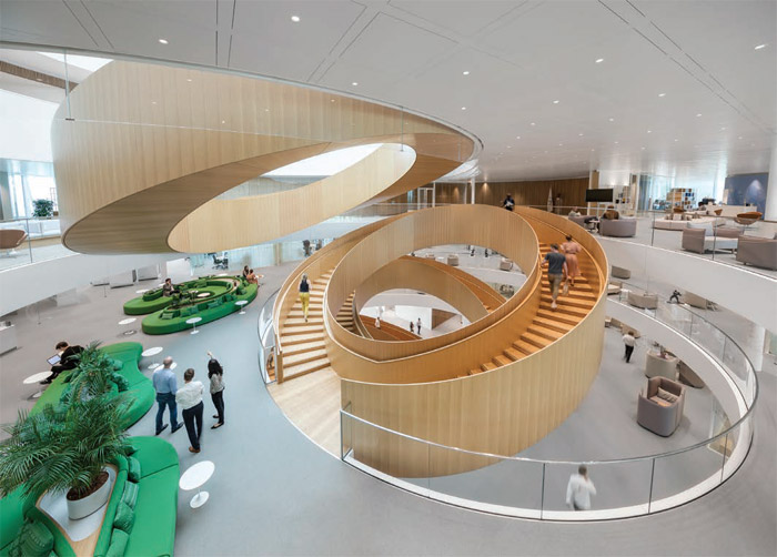 'The Unity Staircase' — a series of five circular, oak staircases recalling the Olympic rings — forms the spatial centerpiece. Credit: 2019 International Olympic Committee (IOC) / Adam Mørk