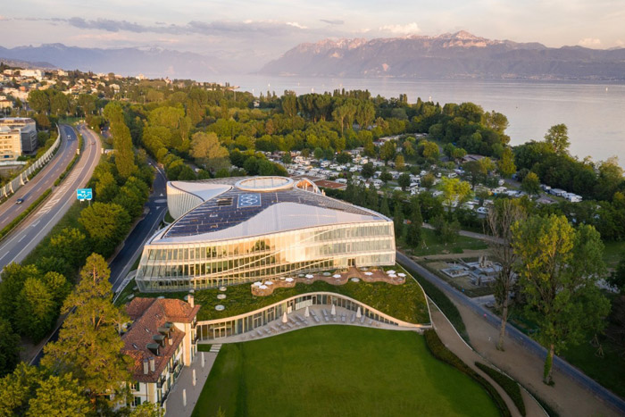 The sloped, green roof covering the projecting ground floor of the building pays respect to the surrounding park. Credit: 2019 International Olympic Committee (IOC) / Adam Mørk