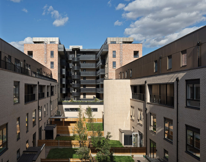 Pitman Tozer Architects' Monier Road complex has a central courtyard which provides shared amenity space as well as small gardens for the family units