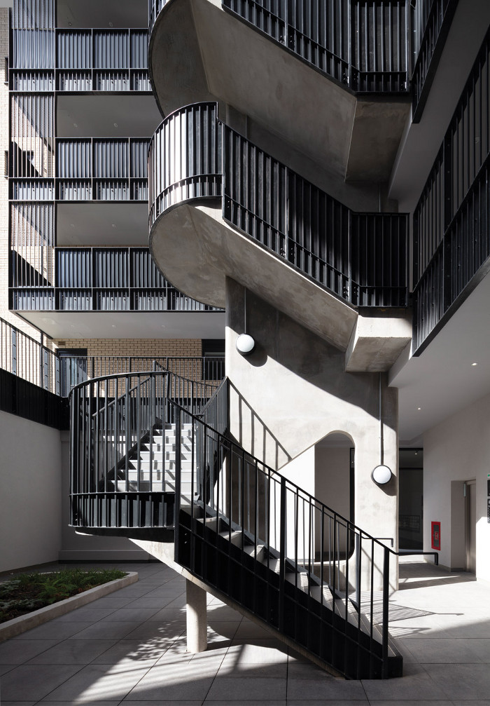 Strong crafted elements at Monier Road include the concrete staircase with its curved steel balustrade. Image credit: Nick Kane.