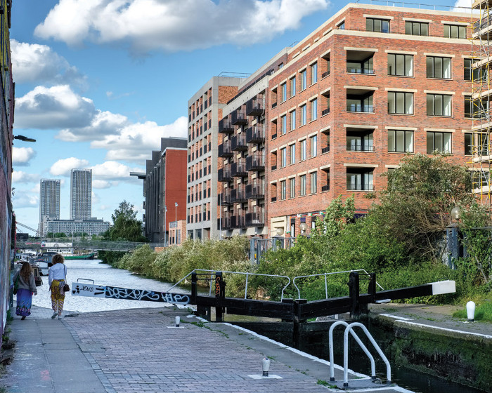 Haworth Tompkins' three Neptune Wharf buildings, part of Fish Island Village, overlook the Hertford Union Canal. Image credit: Fred Howarth.