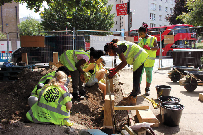On site: young people learn skills collaboratively constructing the Build Up Hackney project