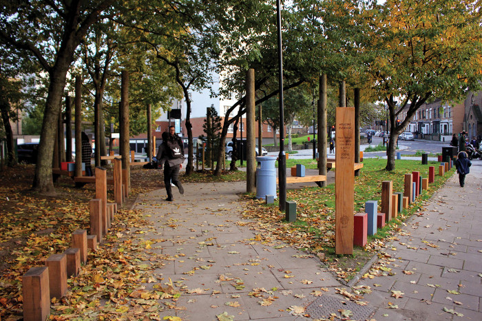 The completed project, a public space with swings and seating, on Flanders Way