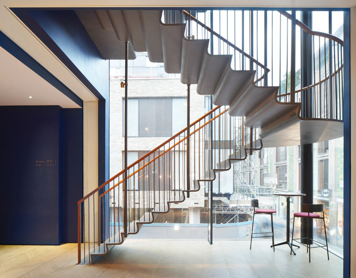 Suspended steel stairs in the theatre complex, with bespoke leather railings.  Image credit: Jack Hobhouse