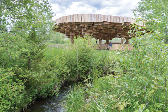 Xylem as seen from the nearby stream, which provides a peaceful soundtrack to the visitor experience. Image Credit: Iwan Baan