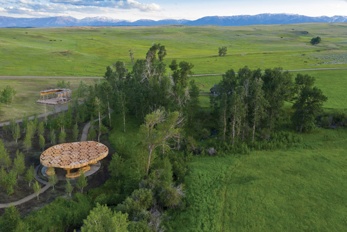 Xylem in the Tippet Rise landscape, with the Tiara Acoustic Shell behind it. Image Credit: Iwan Baan