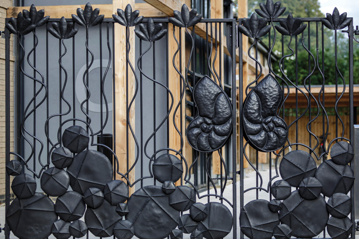 Lucy Cavendish College, Cambridge University:  This gate and railing project took the design of the school's shield as a starting point, to featured water lilies and nautilus shells as its central motif. Simon says: 'As with many commissions the design went through a number of revisions to meet the client's wishes. In this case we learned to take a harder line in future, to protect the integrity of the design.'