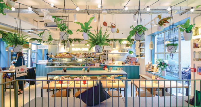 Sweaty Betty makes customers feel right at home in an experience-led store that combines shopping, leisure and food. The plants tap into the trend of wellbeing that is important to younger shoppers