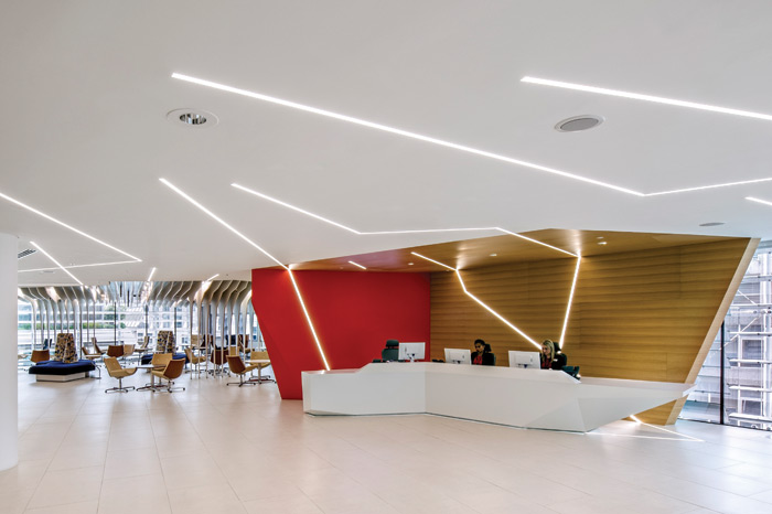 The reception has a striking red wall and lighting that is reminiscent of lighting bolts