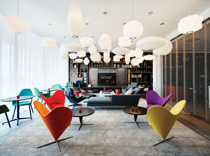 The lounge area is furnished with furniture items from Vitra