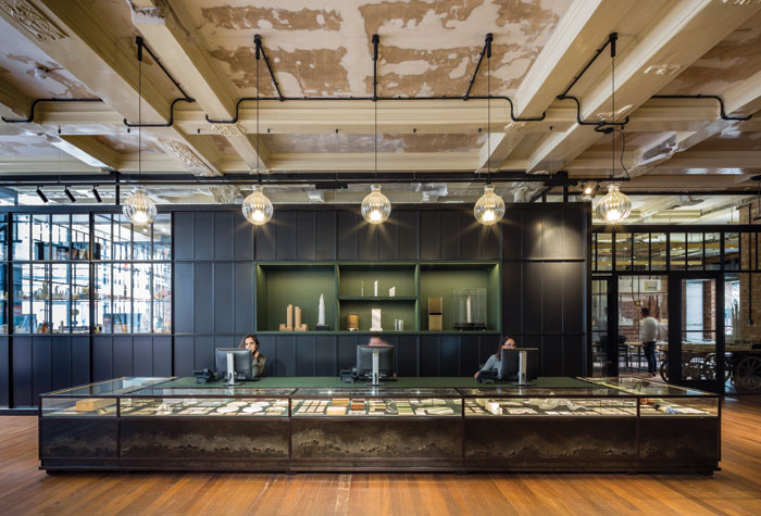 Above the reception desk are five custom-made glass pendant lights from Czech glass studio Lasvit