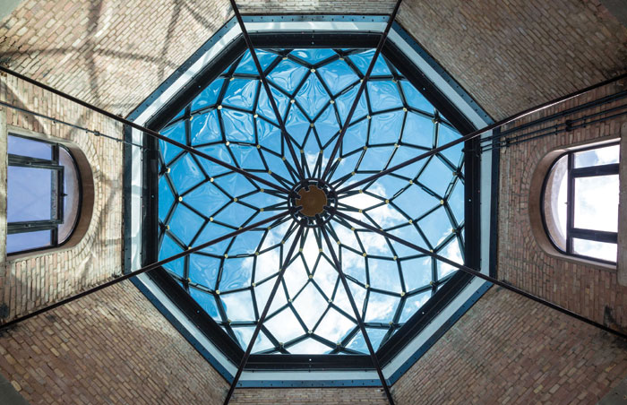 A new crafted glass dome replaces the dilapidated cupola from times gone by